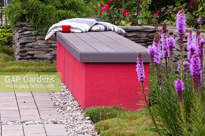 Geometrical bench in modern style garden with Liatris spicata