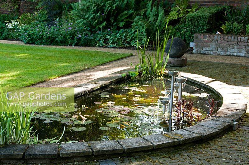 Gap gardens semi circular garden pond with water lilies for Circular garden ponds