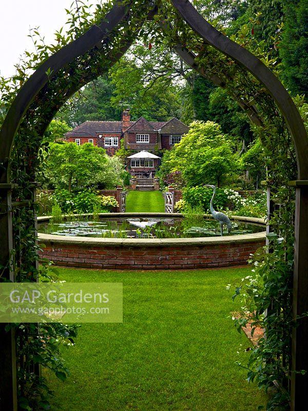 Jasmine Terrace: View Through Arch Clad In Jasmine, Of Raised