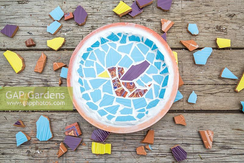 Mosaic bird bath made from broken tiles