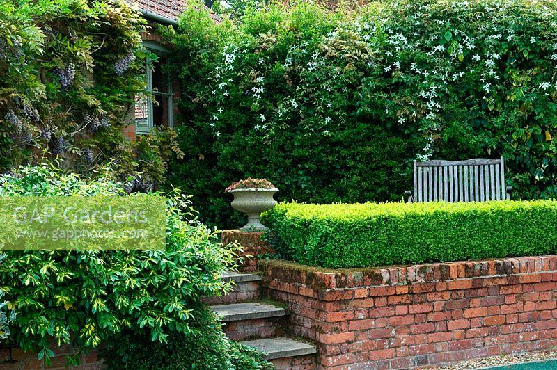 Gap Gardens Steps Beside Low Brick Wall In A Corner