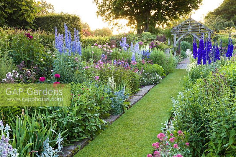 The Sundial Garden at Wollerton Old Hall Garden, Wollerton, Shropshire - featuring David Austin roses, Stachys, Delphiniums, Dahlias, Phlox paniculata, Salvia microphylla and Centranthus ruber, among a wide range of other herbaceous plants.