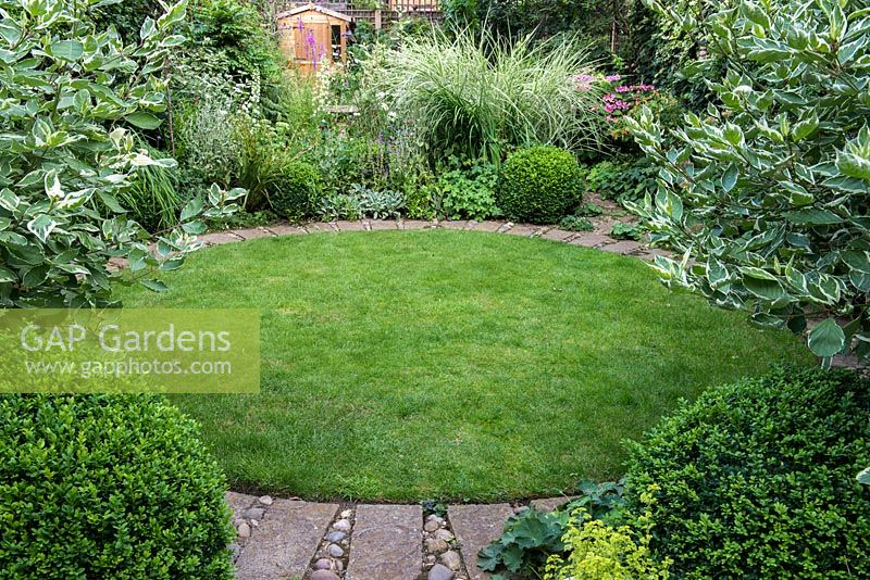 GAP Gardens A Town Garden With Circular Lawn Surrounded By A Stone Interesting Decorative Grass Balls