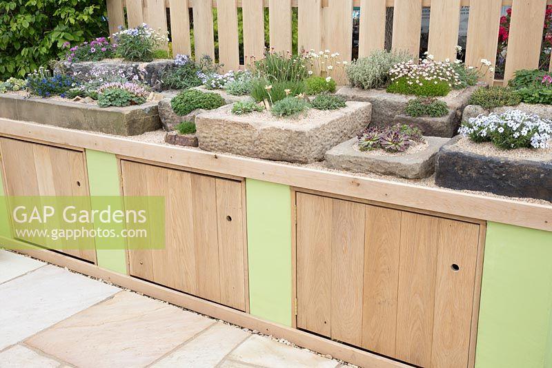 Gap gardens outdoor storage bench with alpine stone for Pip probert garden designer