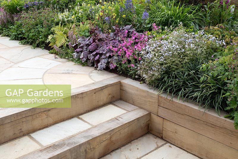Gap gardens stone paving with steps leading to sunken for Pip probert garden designer