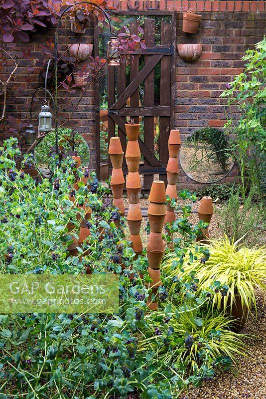 terra cotta gravel gap gardens a gravel garden with terracotta pot sculpture
