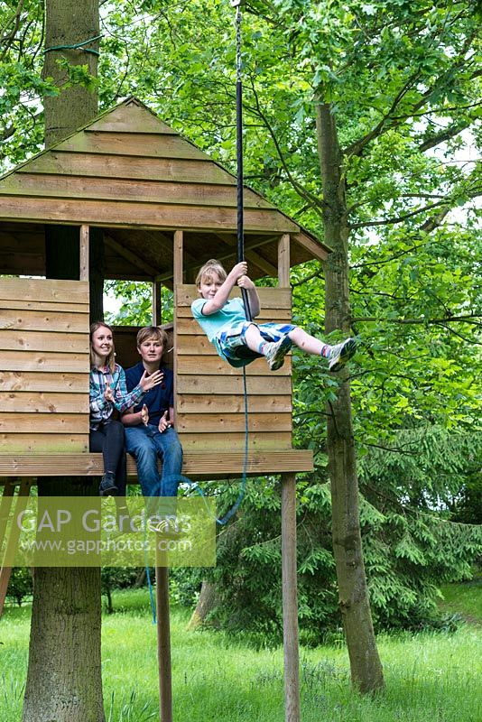 In the treehouse, Victoria and Freddie push off Ludo on the zip wire.