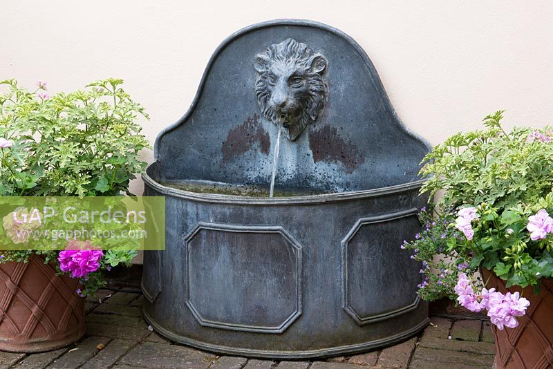 Gap gardens a small decorative metal water feature with water spout and trough image no - Decorative water spouts ...