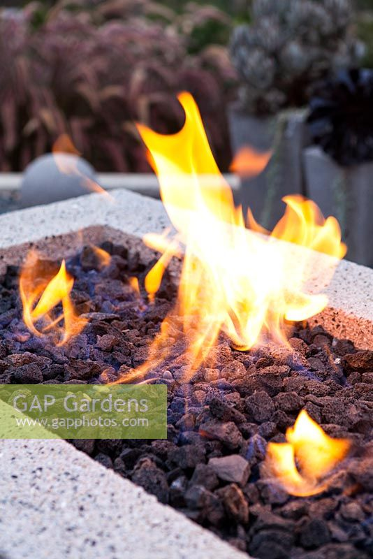 Gas fired fire pit.