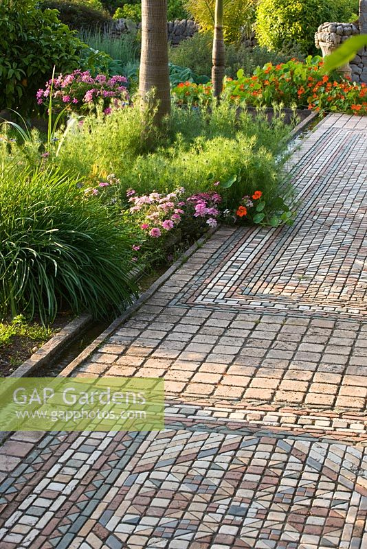 GAP Gardens - The arabic garden - stone and tiled pathways inlaid ...