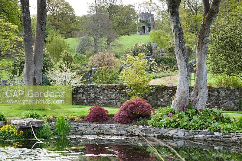 Gap gardens circular pond near the house with walled for Circular garden ponds