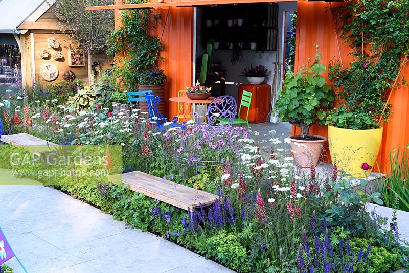 rhs greening grey britain garden colourful flower and veg pots old painted shipping container