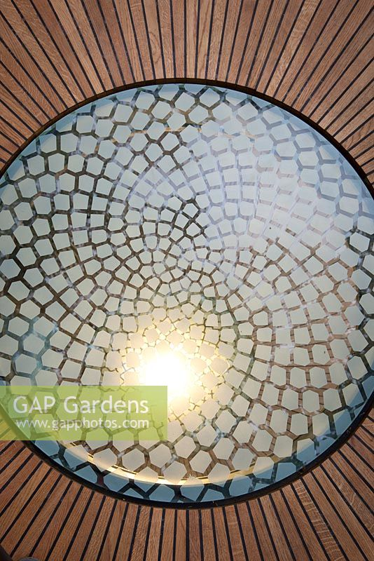 Detail of illuminated glass panels emulating the mathematically perfect Fibonacci spiral inset into the wooden floor of the belvedere in the Winton Beauty of Mathematics, Chelsea Flower Show 2016.