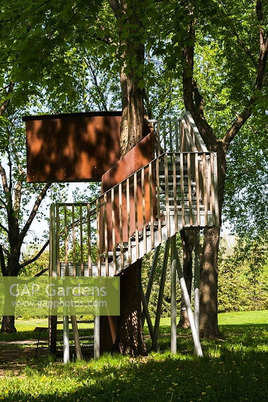 Elevated observation deck - treehouse built between two Acer - Maple trees in spring, Montreal Botanical Garden, Quebec, Canada