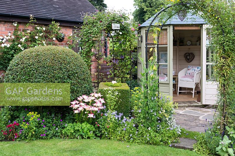 Gap gardens a cottage garden with summer house clematis covered arch topiary box and privet - Mixed style gardens ...