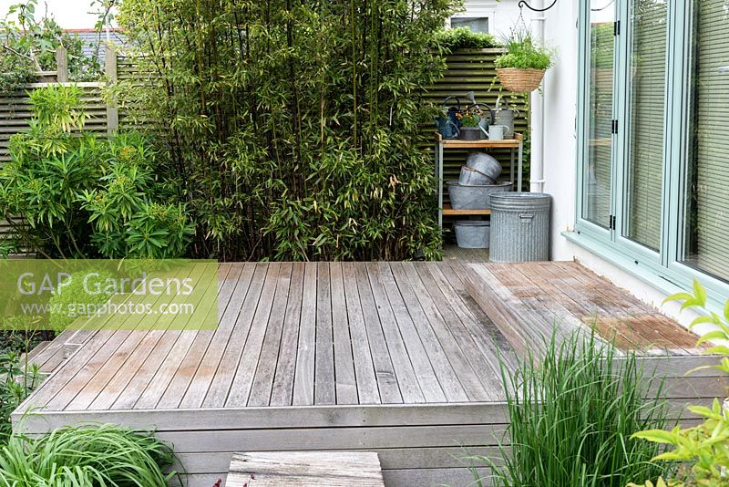 An empty wooden deck measuring 3m x 4m, before planted pots are added.