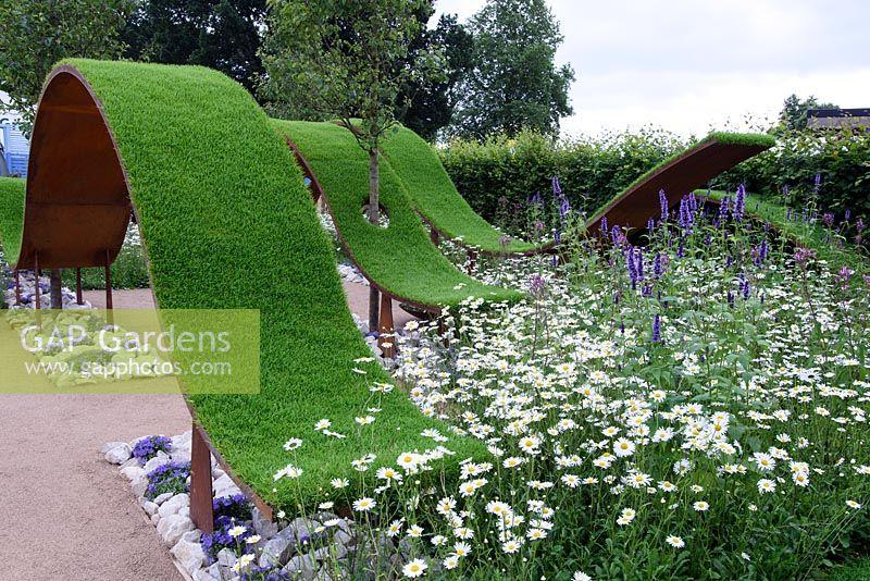 GAP Gardens - The World Vision Garden. Floating waves of turf under ...