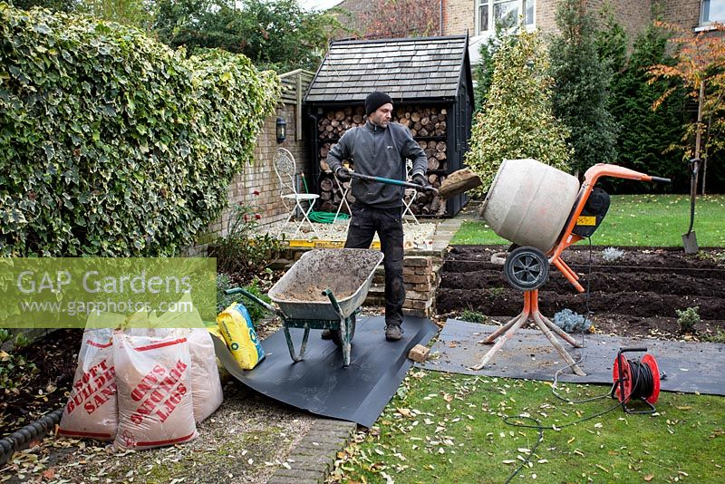 Superieur Stepped Border In London Garden   Builder Mixing Cement For Foundations