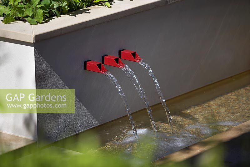Squire's 80th Anniversary Garden. Water feature.  RHS Hampton Court Palace Flower Show  2016. Designer: Catherine MacDonald. Sponsor: Squire's Garden Centres.