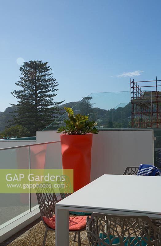 GAP Gardens - A glass fronted swimming pool by a white ...