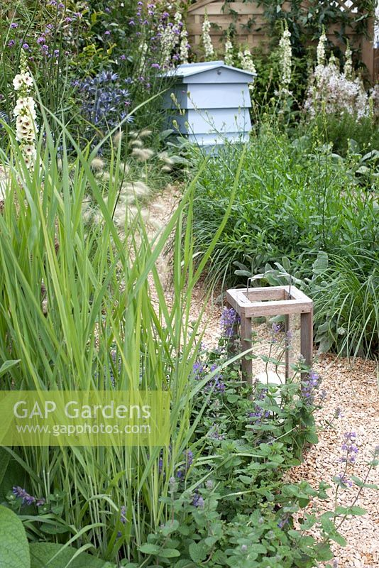 Beehive surrounded by drought tolerant planting in The Drought Garden at RHS Hampton Court Palace Flower Show 2016