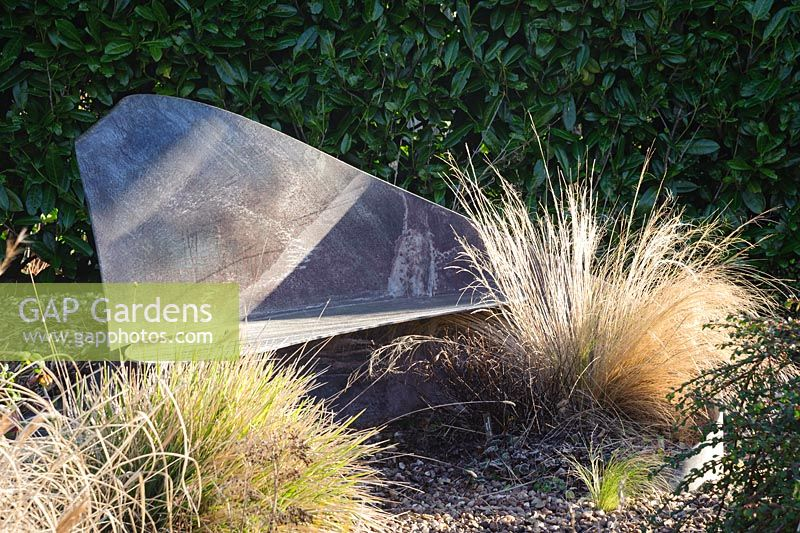 Simple Slate Seat In The Gravel Garden Surrounded By Deciduous Grasses.  Windy Ridge, Little