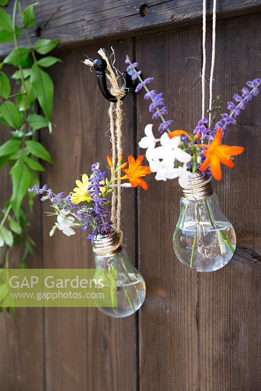 Home made hanging vase made from a lightbulb - hang two or more vases together for a pretty display