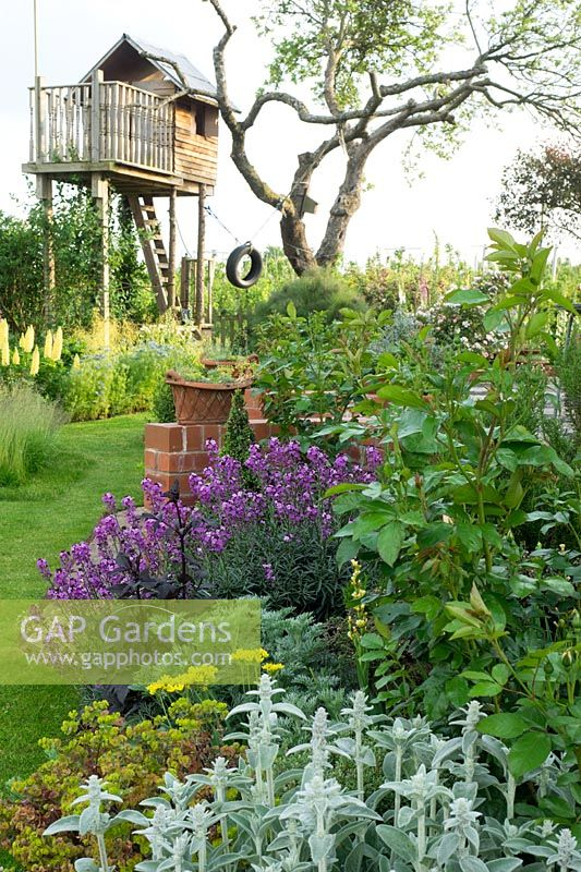 Summer planting with tree house retreat