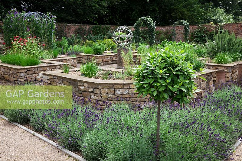 The Herb Garden In Walled Kitchen Garden With Focal Point Armillary Sphere  By David Harber. Raised Beds Made Of Drystone Walls Surrounded By Lavandula  U0027 ...