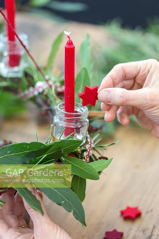 Adding red felt stars to small glass jars