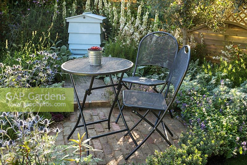 Small summer cottage style garden with brick patio, metal table and chairs,  and silver - GAP Gardens - Small Summer Cottage Style Garden With Brick Patio