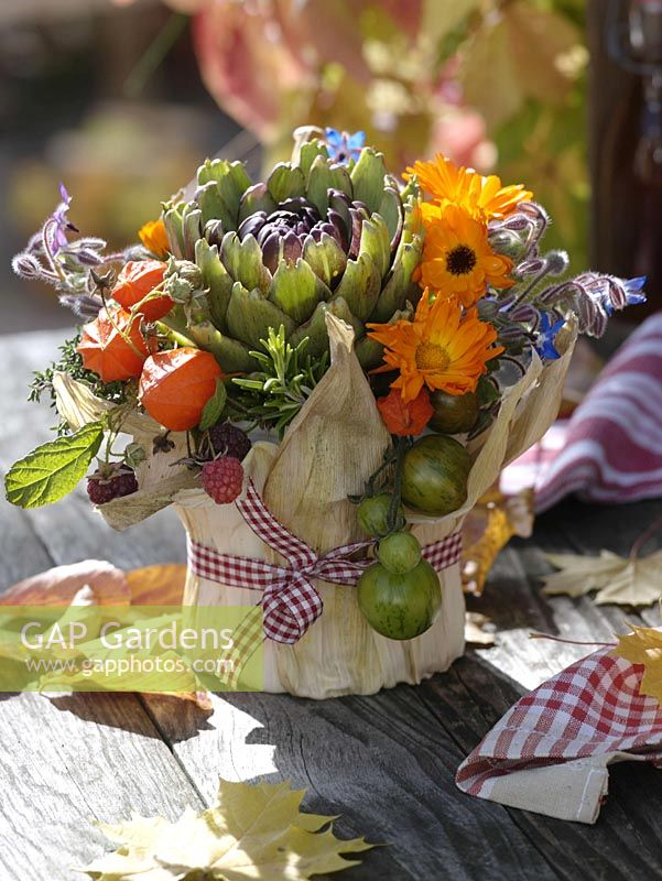 Thanksgiving arrangement in yogurt bucket of maize leaves pasted 3/3