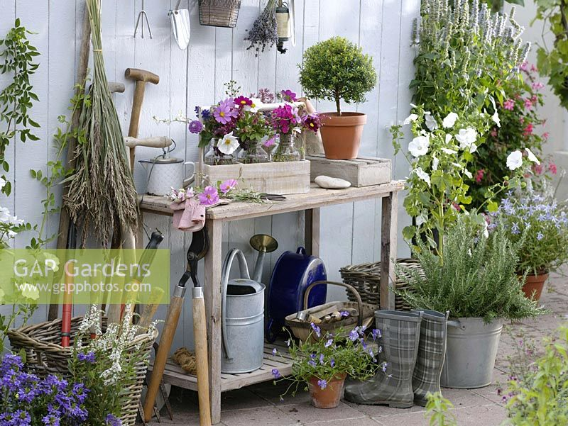 Worktable with small bouquets of summer flowers