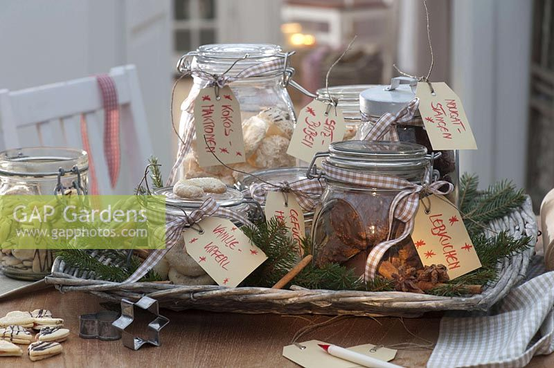 Jars of homemade cookies on wicker tray