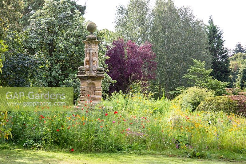 A neo-classical monument emerges from a flower meadow at Newby Hall Gardens, Yorkshire.