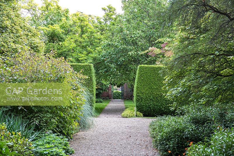 A view of the formal borders, hedging and path at Newby Hall and Gardens, Yorkshire.