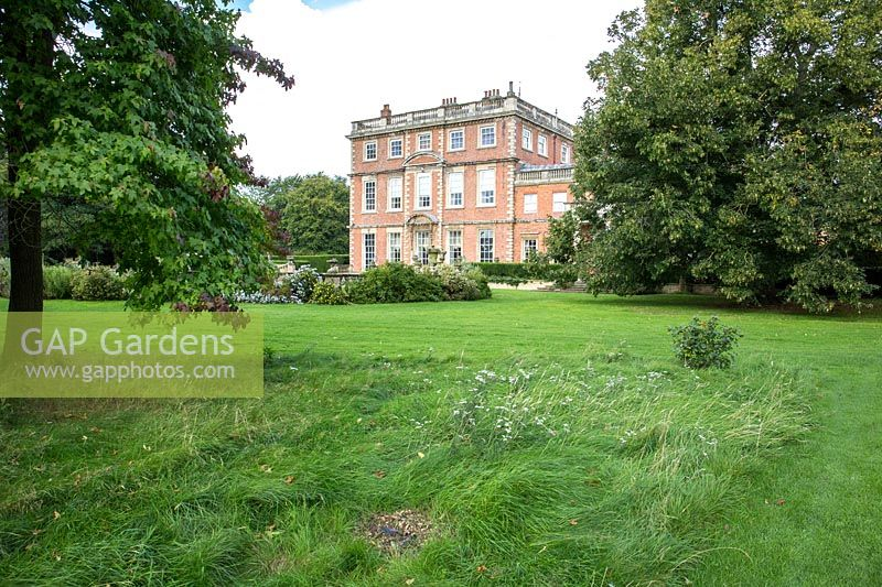 A view across meadow and lawn to the house at Newby Hall and Gardens, Yorkshire.