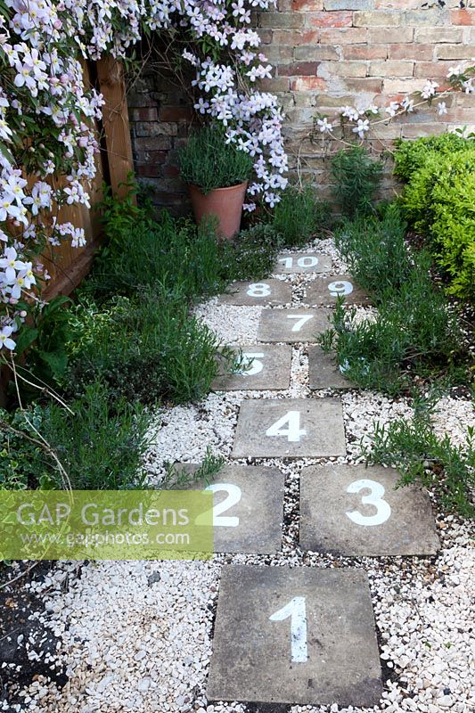 Scented herbs border a hopscotch run.