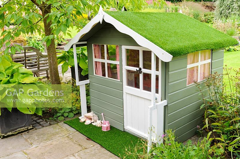 Child's wendy house topped with astroturf, Newport, Wales.
