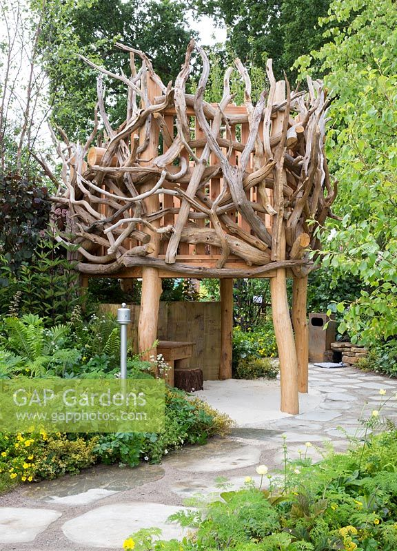 Wooden nest treehouse made from driftwood. Zoflora and Caudwell Children's Wild Garden - RHS Hampton Court Palace Flower Show 2017