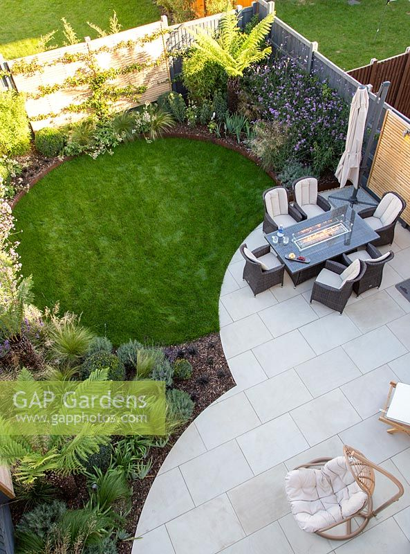 View from above of seating area and lawn in suburban garden