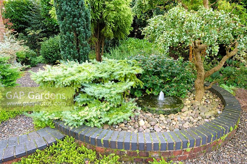 Gap Gardens Circular Raised Bed Of Shrubs And Trees And Water