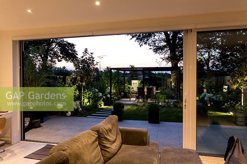 Artificial garden lights from illuminated living area of house
