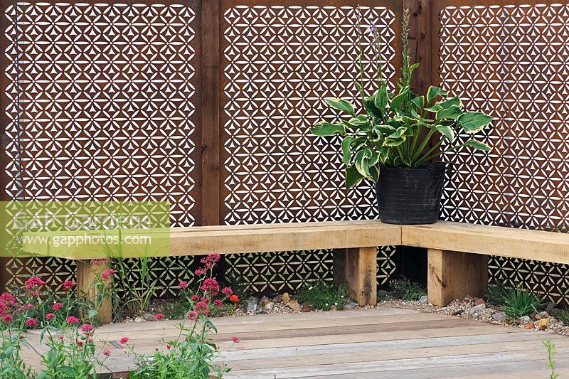 Timber seat with Corten steel fencing panels. Finding Urban Nature Garden, RHS Tatton Park