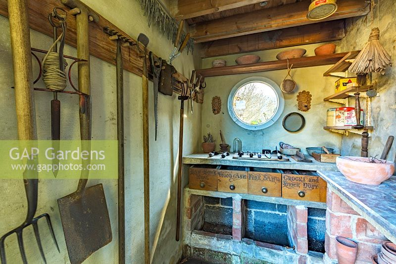 View of workbench and tools inside potting shed. York Gate garden, Leeds, UK.