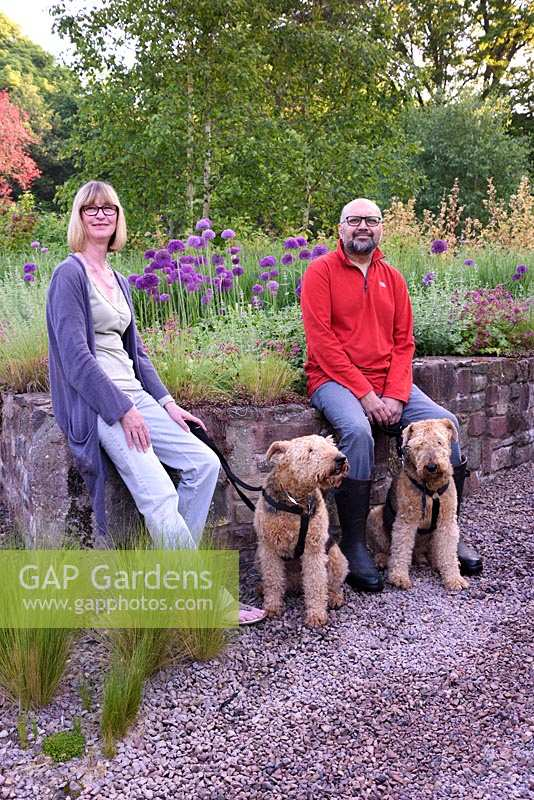 Kate and Hitesh Patel with Airedale terriers, Gloucester, UK