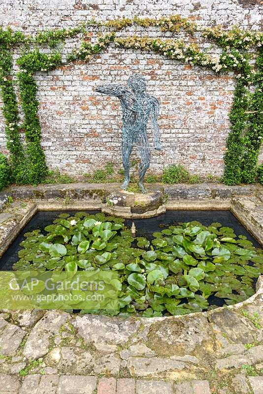 The Demi Lune small pond with waterlilies and Archer Sundial by Robert Rattray.
