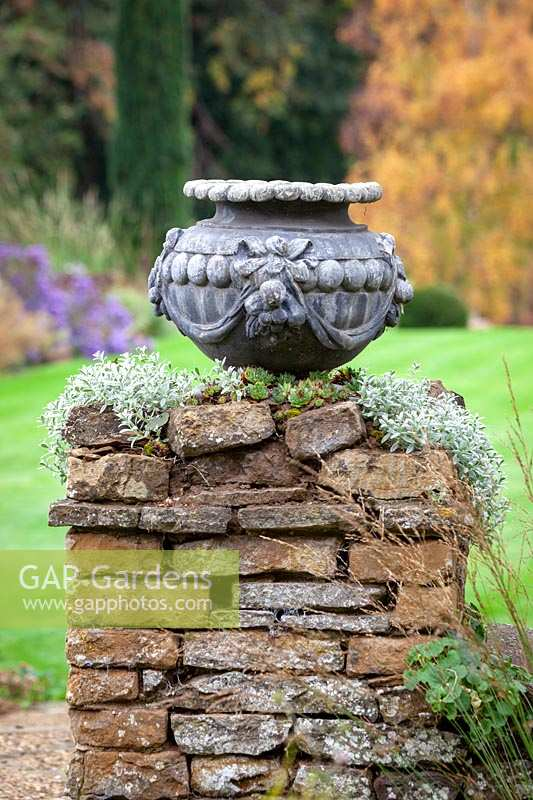 Empty urn on stone pillar at Pettifers