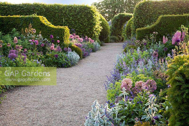 Summer borders with clipped hedges. Arundel Castle, West Sussex, UK