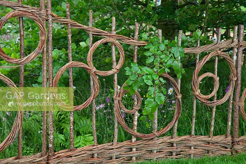 Hazel and willow decorative fence in pattern of circles in the show gardenBelmond Enchanted Gardens